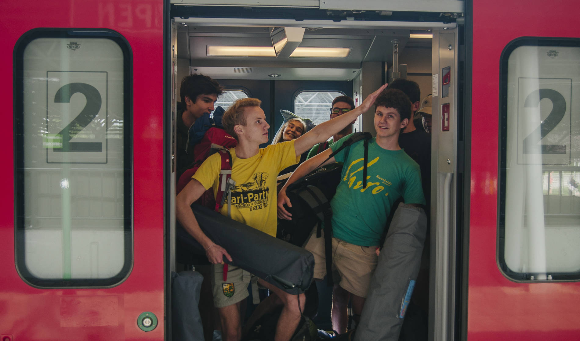 Leiding van Chiro in de trein
